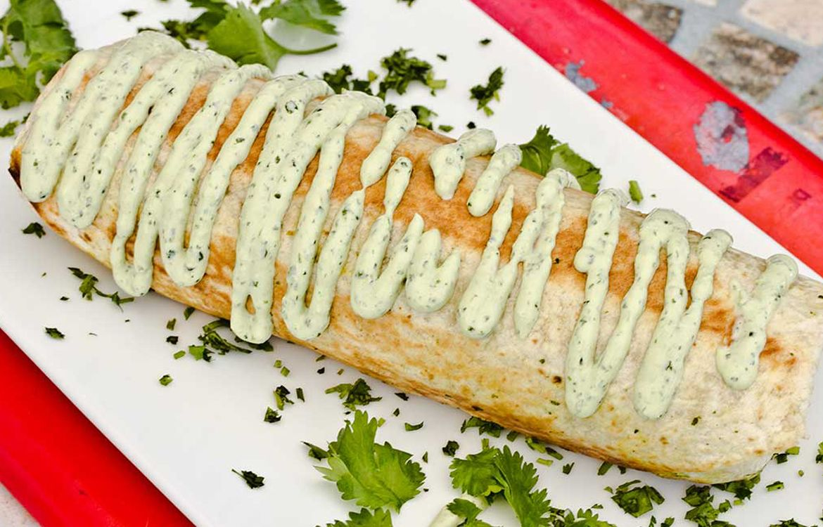 Huge Burrito Grilled and Stuffed with Cilantro Sauce